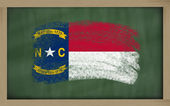 Flag of us state of north carolina on blackboard painted with ch — Stockfoto