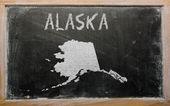 Outline map of us state of alaska on blackboard — Stock Photo