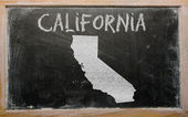 Outline map of us state of california on blackboard — Stock Photo