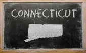 Outline map of us state of connecticut on blackboard — Stock Photo
