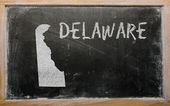 Outline map of us state of delaware on blackboard — Stock Photo