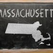 Outline map of us state of massachusetts on blackboard - Stock Photo