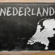 Outline map of netherlands on blackboard — Zdjęcie stockowe