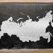 Outline map of russia on blackboard — Stock Photo