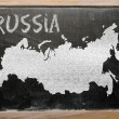 Outline map of russia on blackboard — Stockfoto