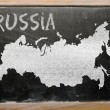 Outline map of russia on blackboard — Stok fotoğraf