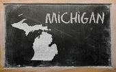 Outline map of us state of michigan on blackboard — Stok fotoğraf