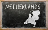 Outline map of netherlands on blackboard — 图库照片