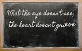 Expression - Waste not, want not - written on a school blackboa — Stock Photo