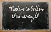 Expression - Wisdom is better than strength - written on a scho — Stock Photo