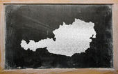 Outline map of austria on blackboard — Stock Photo
