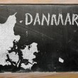 Outline map of denmark on blackboard — Stock Photo