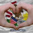 Stock Photo: Over americstate flag of illinois showed heart and love gestu
