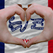 Stock Photo: Over americstate flag of iowshowed heart and love gesture m