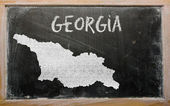 Outline map of georgia on blackboard — Stock Photo