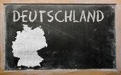 Outline map of germany on blackboard — Stock Photo