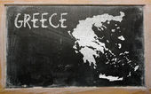 Outline map of greece on blackboard — Stock Photo
