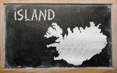 Outline map of iceland on blackboard — Stock Photo