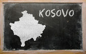Outline map of kosovo on blackboard — Stock Photo