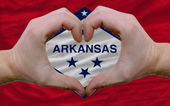 Over american state flag of arkansas showed heart and love gestu — Stock Photo