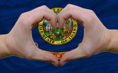 Over american state flag of idaho showed heart and love gesture — Stock Photo