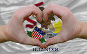 Over american state flag of illinois showed heart and love gestu — Stock Photo