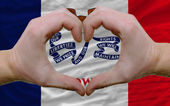 Over american state flag of iowa showed heart and love gesture m — Stock Photo