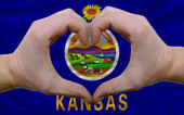 Over american state flag of kansas showed heart and love gesture — Stock Photo