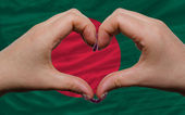 Over national flag of bangladesh showed heart and love gesture m — Stock Photo