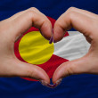 Over american state flag of colorado showed heart and love gestu — Stock Photo #9010008