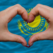 Over national flag of kazakhstshowed heart and love gesture m — Stock Photo #9010862