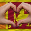 Over national flag of srilanka showed heart and love gesture mad - Stock Photo