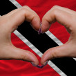 Over national flag of trinidad tobago showed heart and love gest — Stock Photo