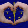 Over american state flag of indiana showed heart and love gestur - Stock Photo