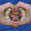 Over american state flag of minnesota showed heart and love gest - Stockfoto