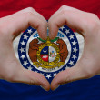 Over american state flag of missouri showed heart and love gestu - Foto de Stock