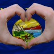 Over american state flag of montana showed heart and love gestur - Stockfoto