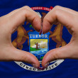Over american state flag of michigan showed heart and love gestu — Stock Photo