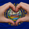 Stock Photo: Over americstate flag of new hampshire showed heart and love