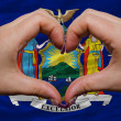 Stock Photo: Over americstate flag of new york showed heart and love gestu