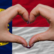 Over american state flag of north carolina showed heart and love — Stock Photo #9014885