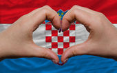 Over national flag of croatia showed heart and love gesture made — Stock Photo