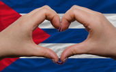 Over national flag of cuba showed heart and love gesture made by — Stock Photo
