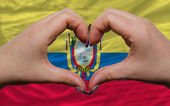 Over national flag of ecuador showed heart and love gesture made — Stock Photo