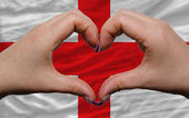 Over national flag of england showed heart and love gesture made — Stock Photo