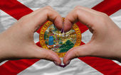 Over american state flag of florida showed heart and love gestur — Stock Photo