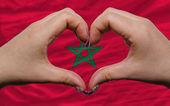 Over national flag of morocco showed heart and love gesture made — Stock Photo