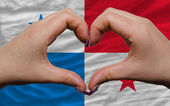 Over national flag of panama showed heart and love gesture made — Stock Photo