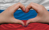 Over national flag of russia showed heart and love gesture made — Stock Photo