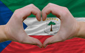 Over flag of equatorial guinea showed heart and love gesture mad — Stock Photo